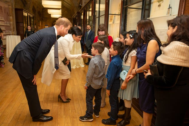 Harry and Meghan meeting with children from Urbanwise