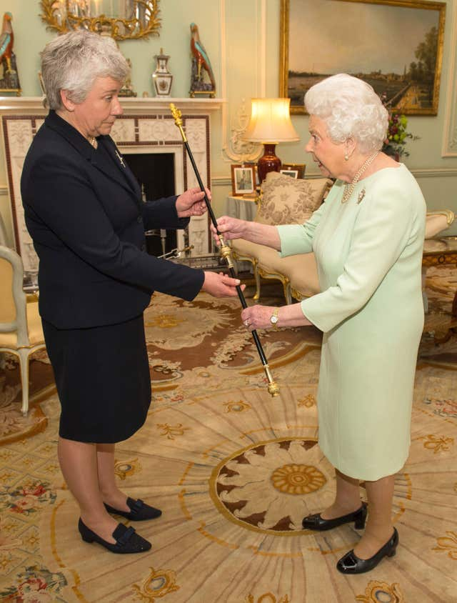 The Queen presents Sarah Clarke with her Black Rod (Dominic Lipinski/PA)