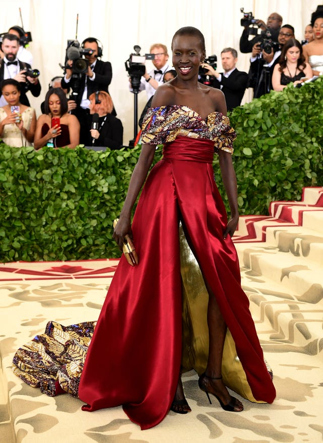 More red, from Alek Wek (Ian West/PA)