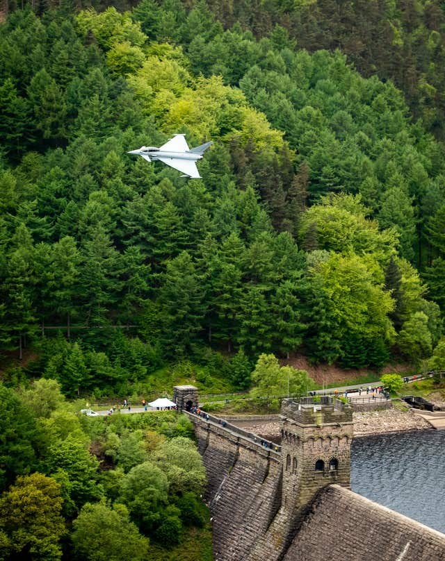A modern RAF Typhoon in a commemorative flypast over the Derwent dam in Derbyshire (Danny Lawson/PA)