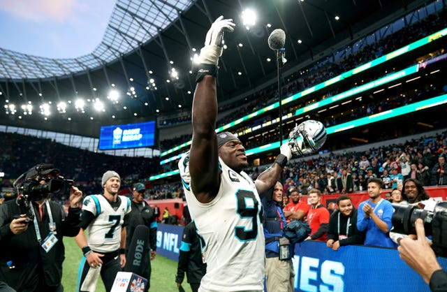 Efe Obada, who used to live on the streets in London, walks off at Tottenham Hotspur Stadium after captaining the Carolina Panthers to victory over the Tampa Bay Buccaneers