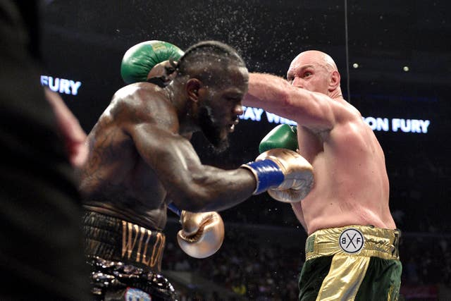 Tyson Fury, right, felt he should have stopped Deontay Wilder inside six rounds