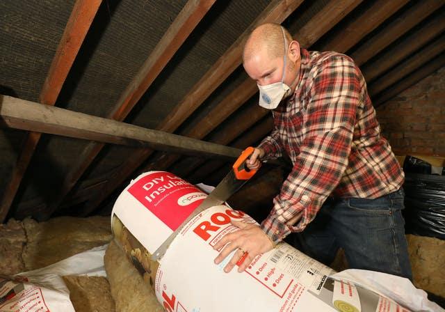 Richard Burr doing loft insulation (Philip Toscano/PA)