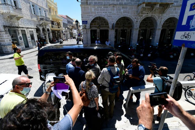 Journalists and photographers gathered in front of a van used to transport Harry Maguire away from court on Saturday