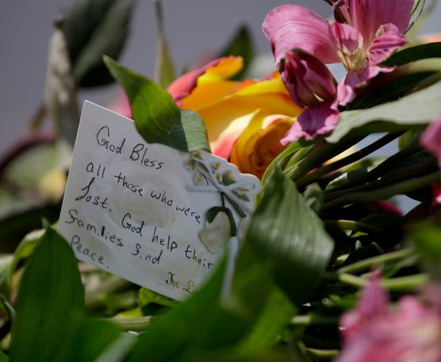 Flowers and a note rest on a car believed to belong to a victim of a the duck boat accident