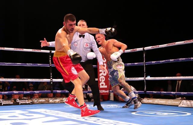 Josh Warrington, right, beats Sofiane Takoucht to retain his IBF world featherweight title