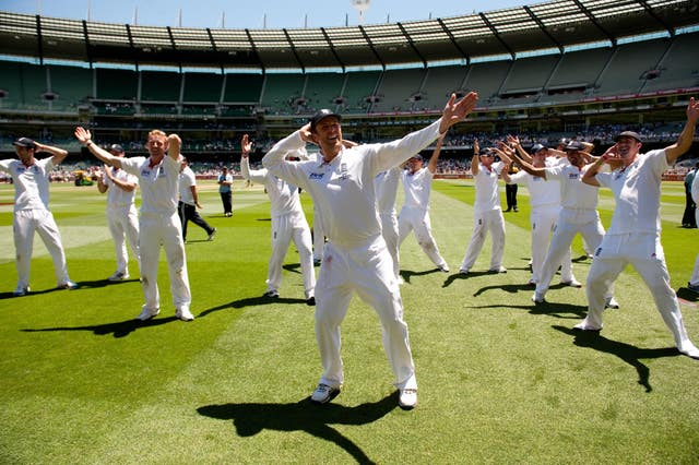 England's players celebrate by doing the sprinkler dance after victory at the MCG