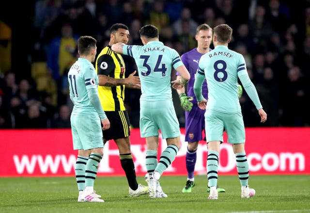 Watford's Troy Deeney (second left) speaks to Arsenal's Granit Xhaka