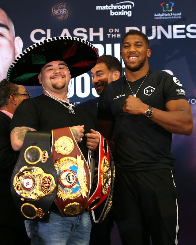 Andy Ruiz Jr shows off the belts he won from Anthony Joshua