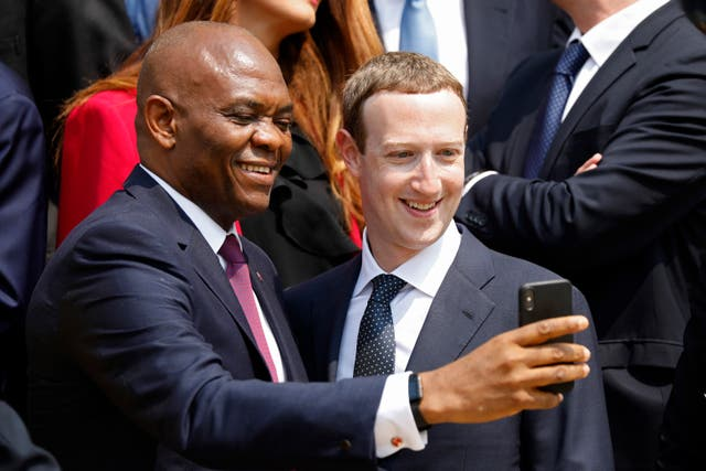 Facebook CEO Mark Zuckerberg takes a selfie with Tony Elumelu, United Bank of Africa chairman (Charles Platiau/AP)