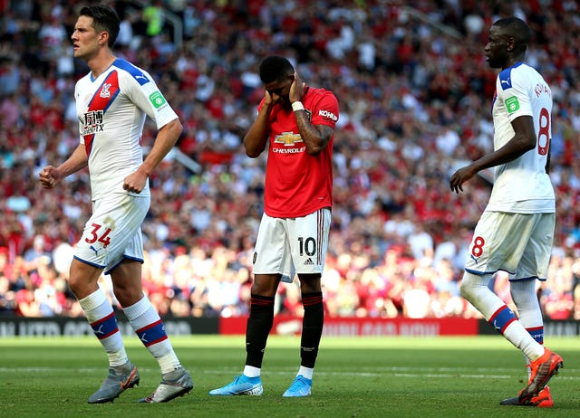 Marcus Rashford appears dejected after missing from the penalty spot