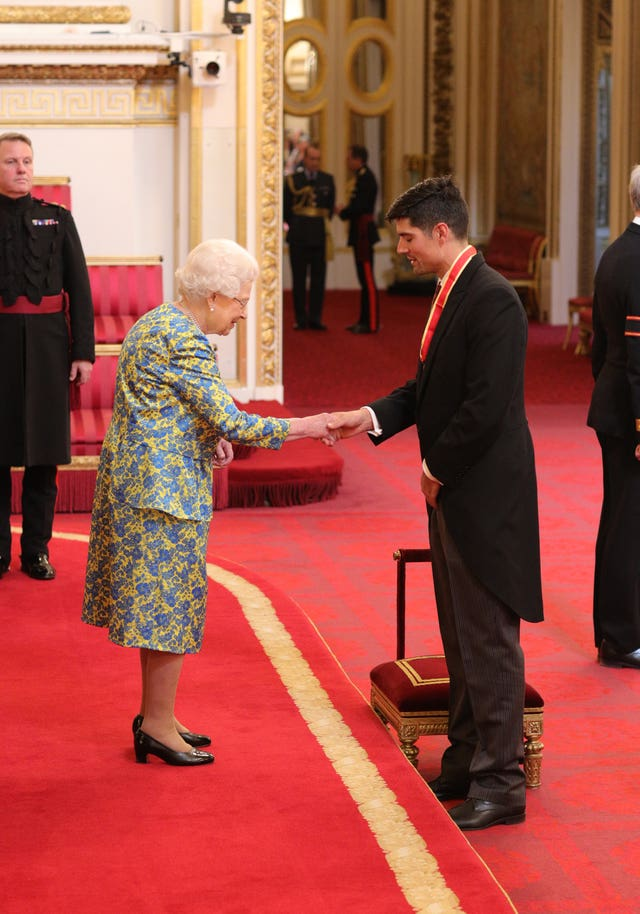 Sir Alastair Cook receives a knighthood for services to cricket from the Queen during an investiture ceremony at Buckingham Palace