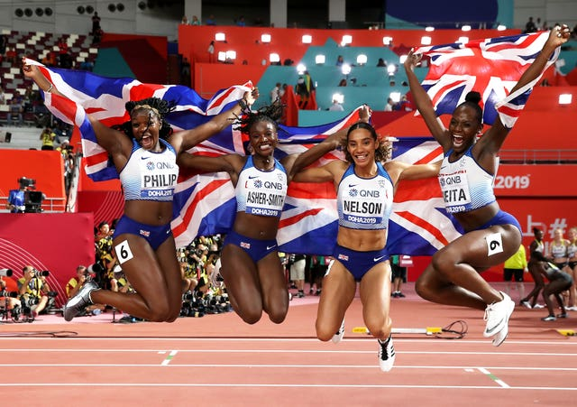 Asha Philip, Dina Asher-Smith, Ashleigh Nelson and Daryll Neita celebrate their 4x100m relay silver