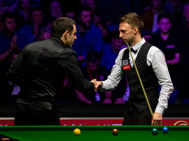 Judd Trump shakes hands with Ronnie O'Sullivan (left) after winning the Masters final (Steven Paston/PA).
