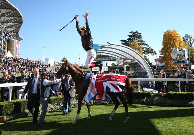 Frankie Dettori jumps for joy after winning with Stradivarius
