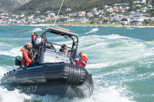 The Duke of Sussex travels on a South African Maritime Police Unit RIB during a visit to Kalk Bay Harbour, in Cape Town on day two of the Royal couple's visit to South Africa