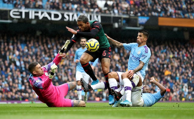Tom Heaton is an admirer of City goalkeeper Ederson (pictured)