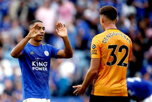 Leicester's Youri Tielemans commiserates with Leander Dendoncker after Wolves were denied victory
