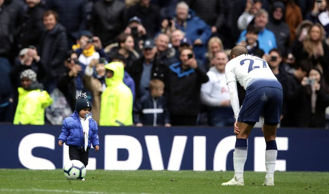 Moura celebrated by having a kickabout with his young son after the match
