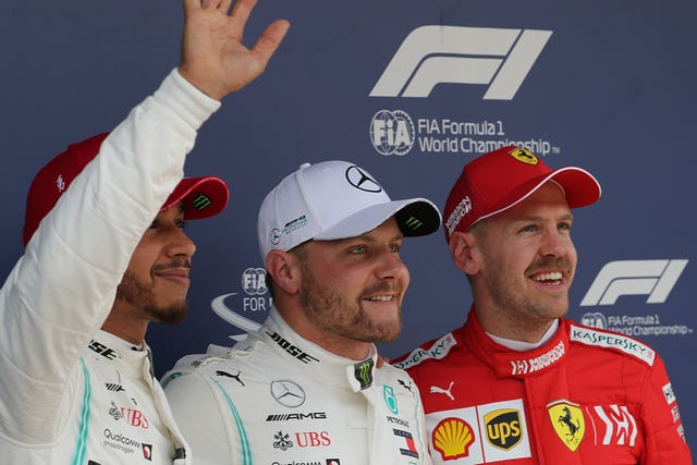 Lewis Hamilton, left,  Valtteri Bottas, centre, and Vettel are on the podium