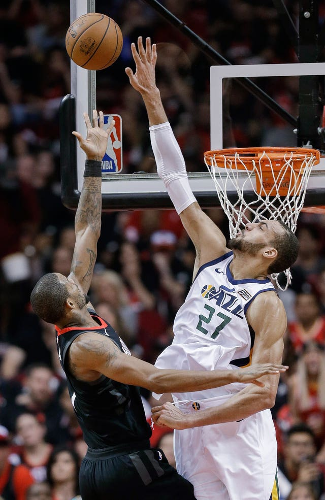 Houston Rockets forward Trevor Ariza, left, shoots as Utah Jazz center Rudy Gobert defends (Eric Christian Smith/AP)