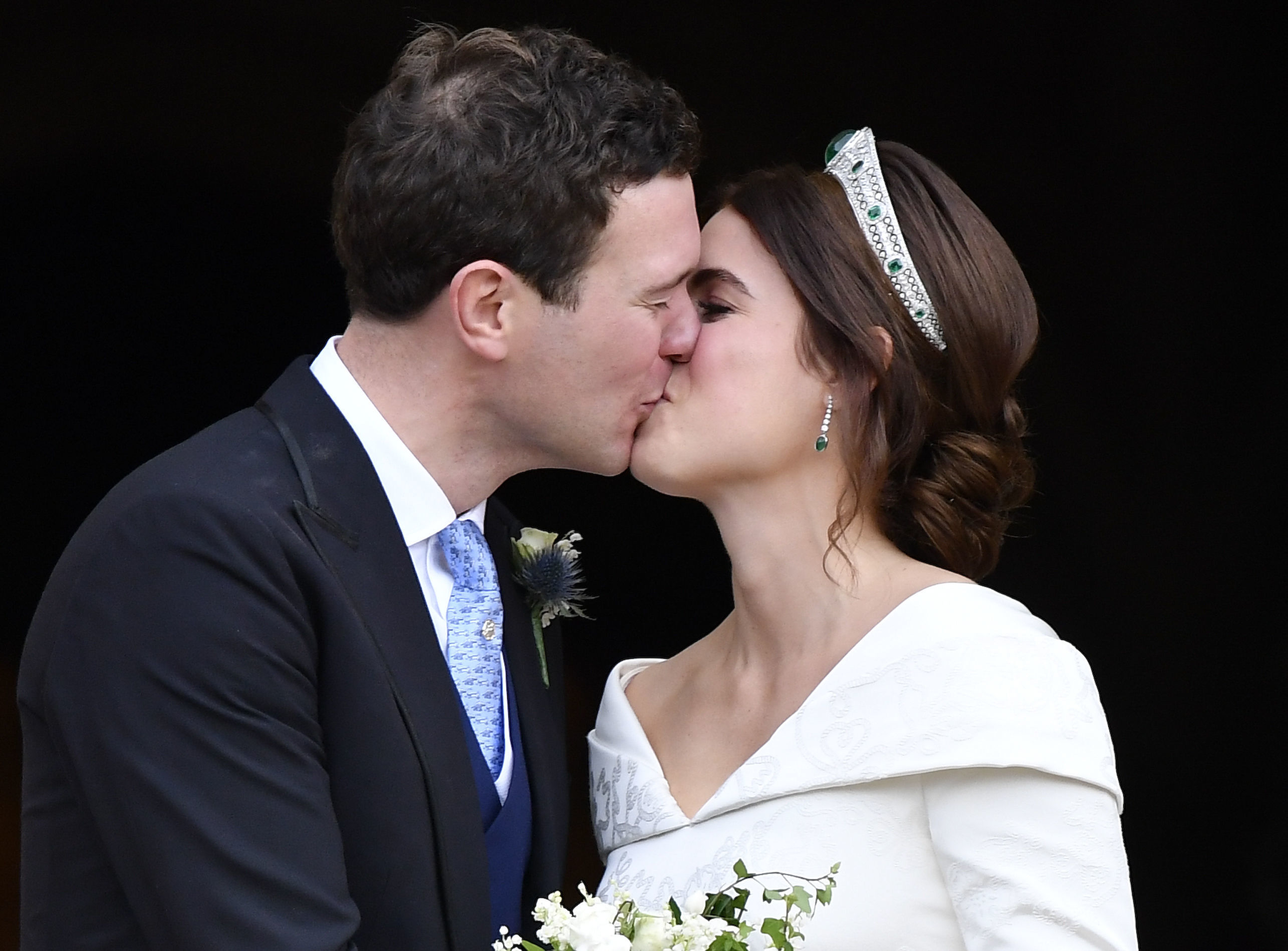 Eugenie and Jack kiss on balcony