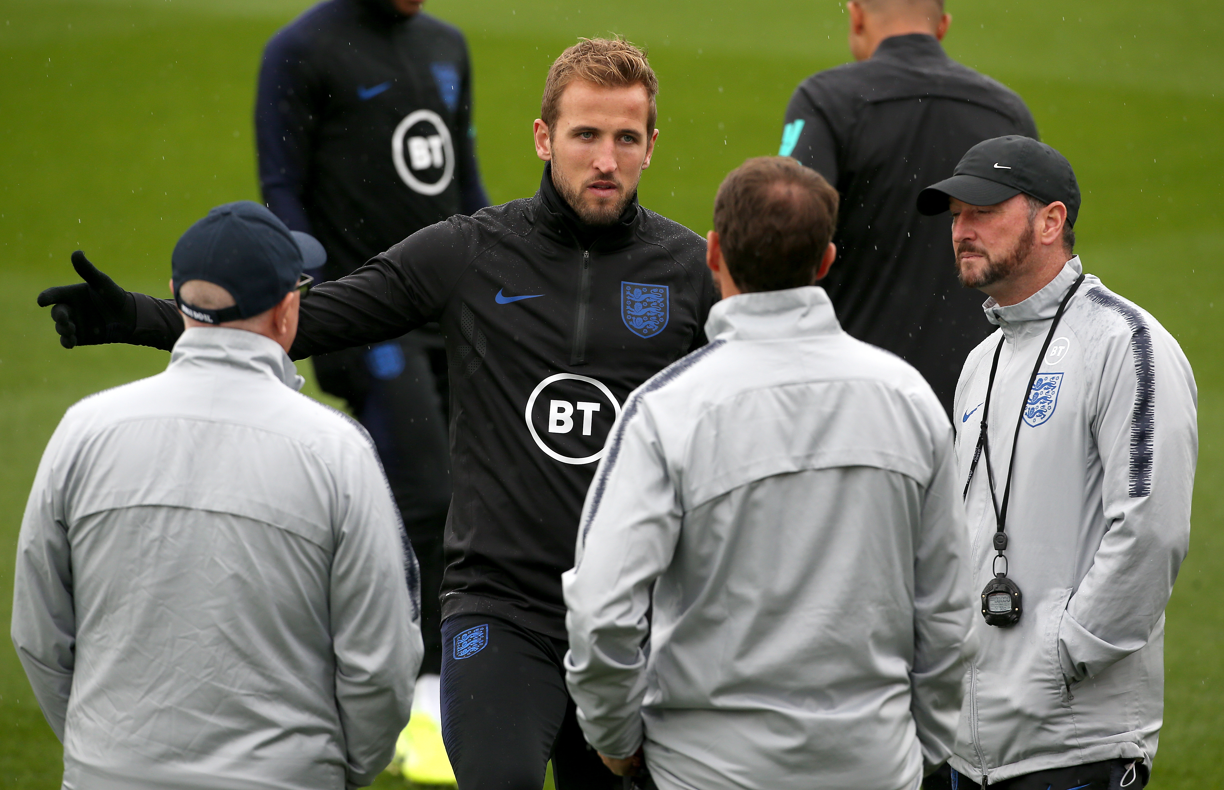 Harry Kane talks with manager Gareth Southgate and his staff