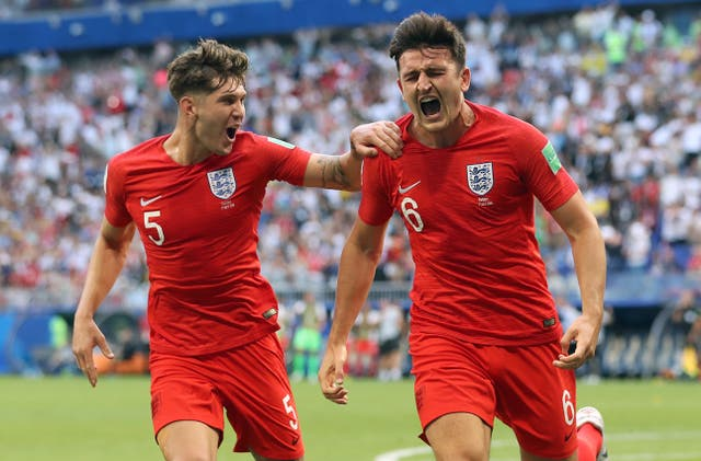 Harry Maguire, right, celebrates his goal against Sweden