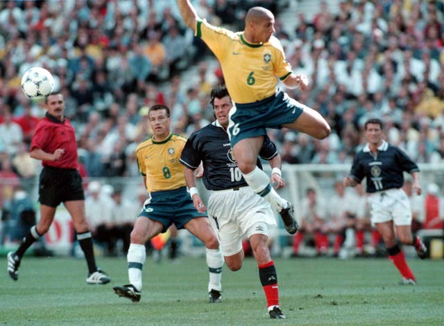 Brazilian Roberto Carlos (centre) admits he does not know how he scored his banana-shot free-kick (Owen Humphreys/PA)