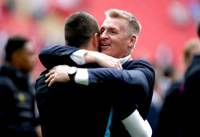 Dean Smith hugs assistant coach John Terry after Villa's play-off final triumph against Derby