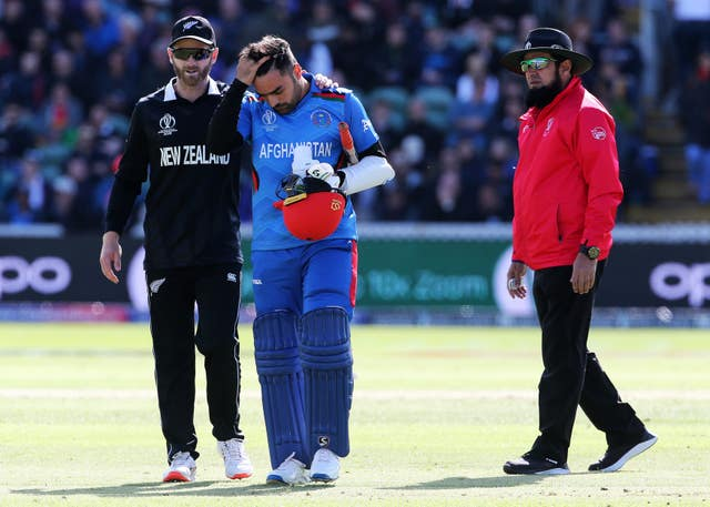 Rashid Khan, centre, took a blow on the helmet and did not bowl in New Zealand's innings (Mark Kerton/PA)
