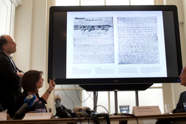 A video shows the text underneath two taped-off pages from Anne Frank's diary during a press conference at The Anne Frank Foundation's office in Amsterdam (Peter Dejong/AP)