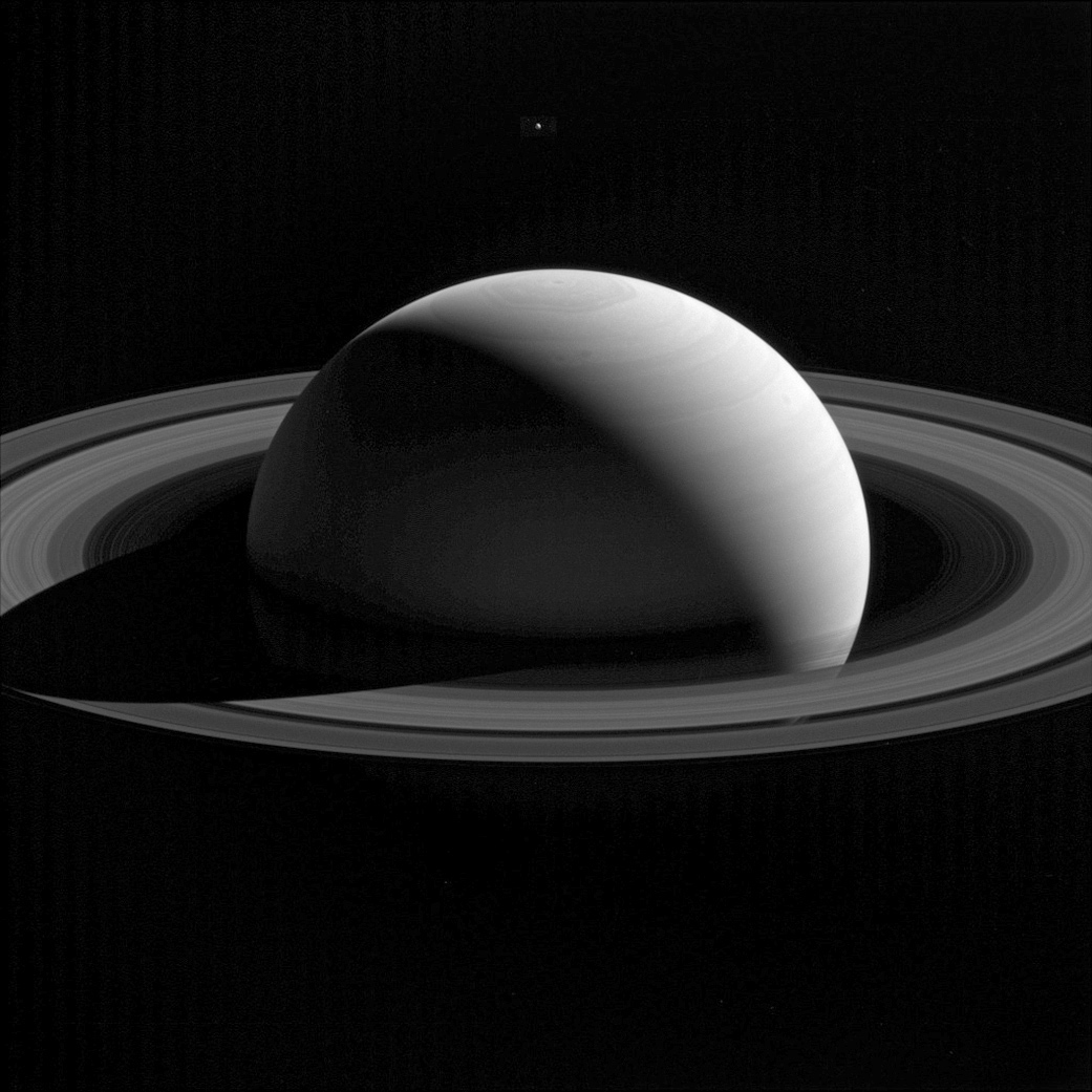 Saturn with one of its moons Tethys taken by the Cassini spacecraft