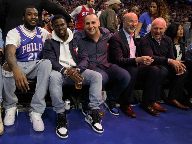 Rapper Meek Mill, left, alongside actor Kevin Hart during a basketball match between Philadelphia 76ers and Miami Heat.