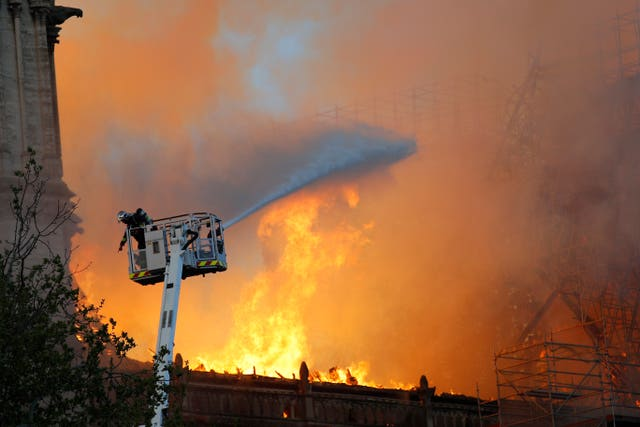 A firefighter tackles the huge blaze