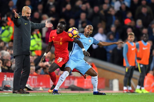 Sadio Mane, centre, is watched by Pep Guardiola