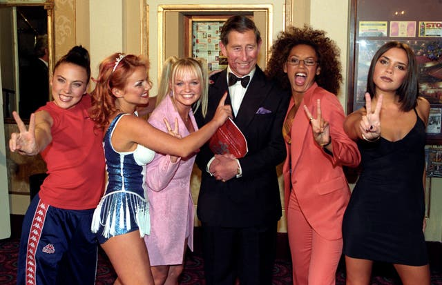 Prince of Wales, with lipstick on his face after being kissed by Mel B and Geri Halliwell, poses with the Spice Girls at the Prince's Trust 21st anniversary concert at Manchester Opera House in 1997. (John Giles/PA)