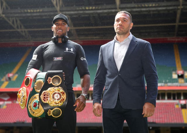 Anthony Joshua, left, defends his WBA, WBF and WBO heavyweight titles against Kubrat Pulev next month (Nick Potts/PA)
