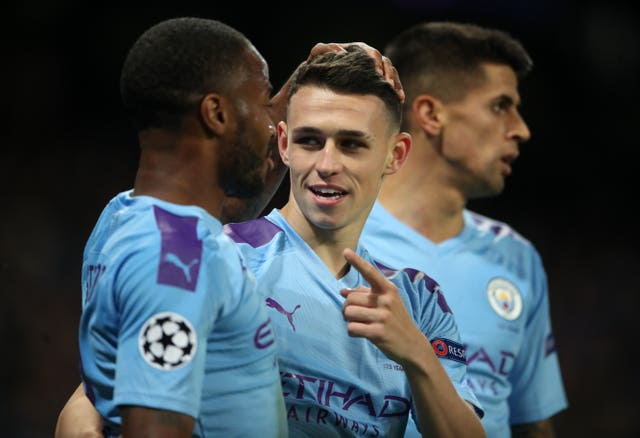 Phil Foden, centre, sealed the victory late on for City