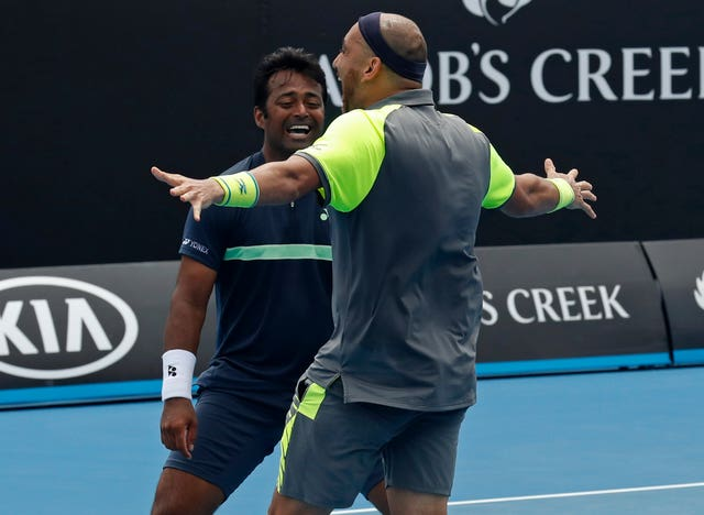 India's Leander Paes, and Purav Raja celebrate after defeating Britain's Jamie Murray and Brazil's Bruno Soares (Ng Han Guan/AP)