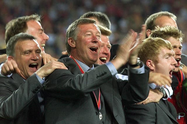 Sir Alex Ferguson celebrates the treble