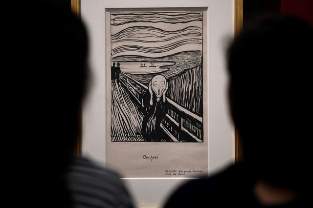 Art handlers during the installation of Edvard Munch's The Scream