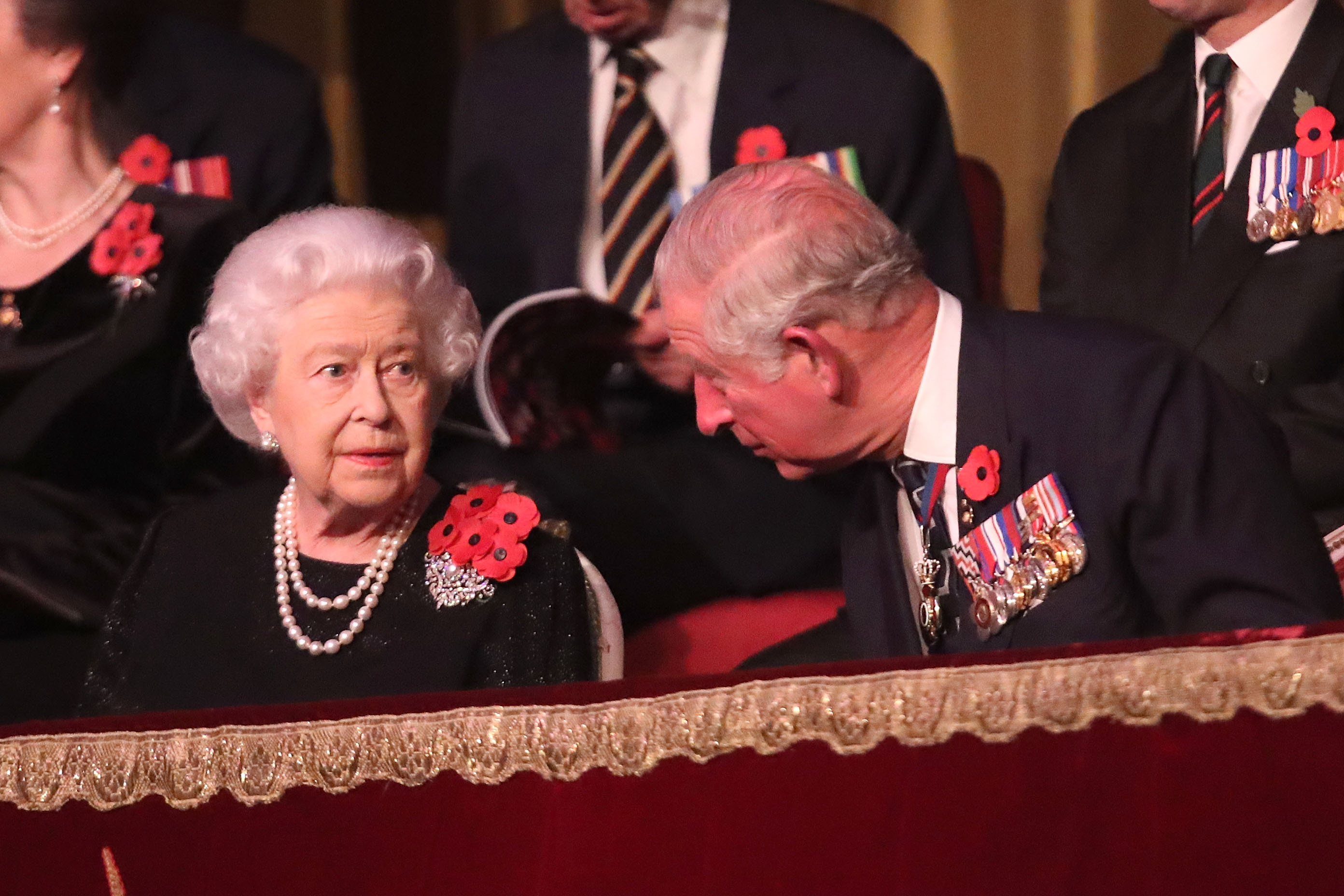 Queen leads Armistice commemorations wearing FIVE poppies