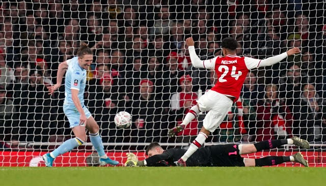 Arsenal's Reiss Nelson scores his side's first goal of the game during the FA Cup third round match at Emirates Stadium