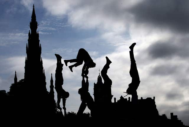 File photo dated 06/06/18 of acrobats from Cirque Berserk helping to launch the Edinburgh Festival Fringe 2018.