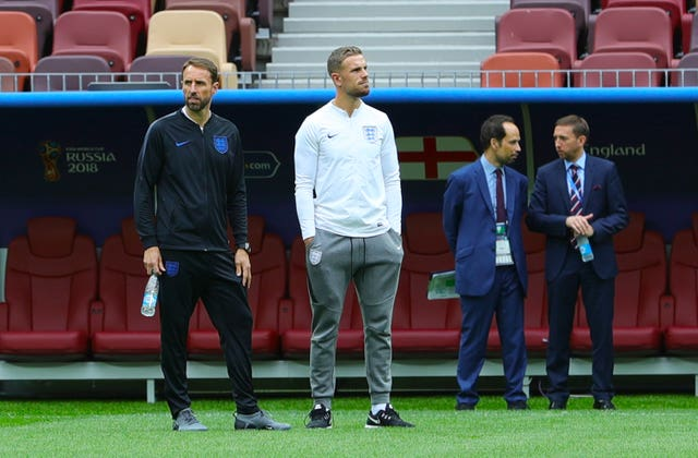 England manager Gareth Southgate, left, and Jordan Henderson during the walkabout at the Luzhniki Stadium