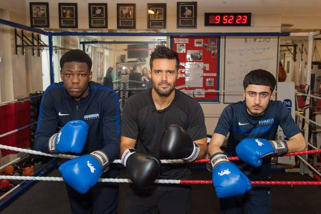 Spencer Matthews (centre) with students Tipoti (left) and Ali (Dominic Lipinski/PA)