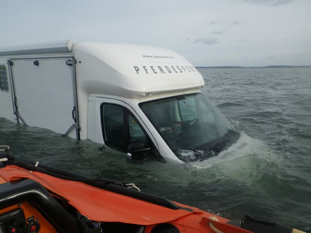 A horsebox type campervan partially submerged on Holy Island causeway