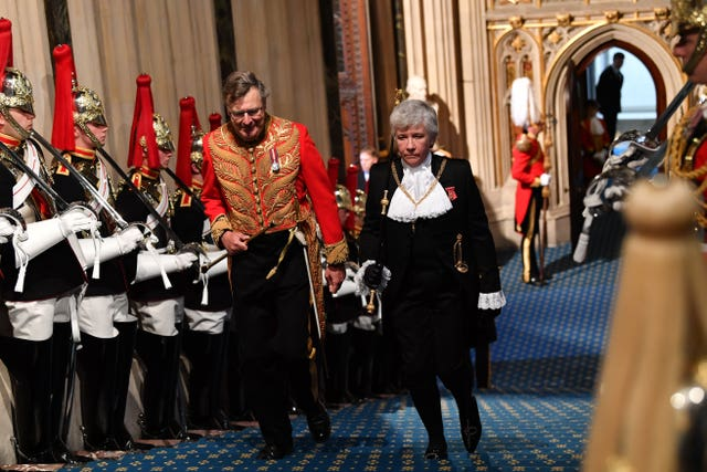 Lady Usher of the Black Rod Sarah Clarke arrives through the Norman Porch for the State Opening