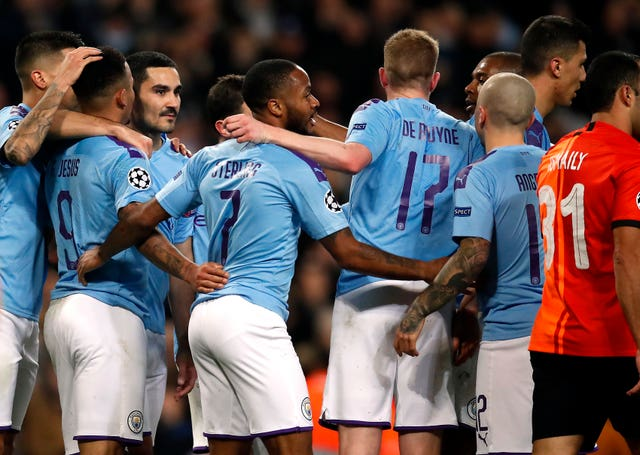 Manchester City celebrate a Champions League goal against Shakhtar Donetsk